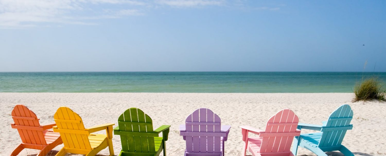 Fun in the Sun - Rainbow Beach Chairs by the Shore