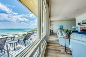 the beach house living room and deck views